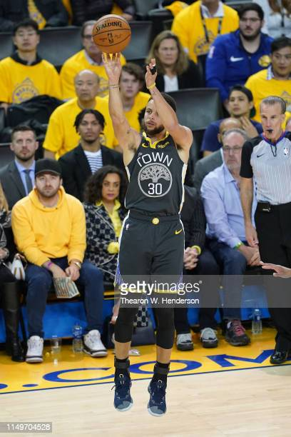 Stephen Curry of the Golden State Warriors takes a shot against the Portland Trail Blazers in game two of the NBA Western Conference Finals at ORACLE...