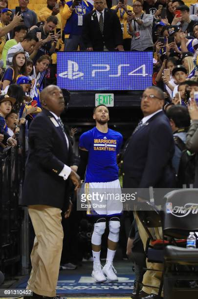 Stephen Curry of the Golden State Warriors takes a shot from the tunnel prior to Game 1 of the 2017 NBA Finals against the Cleveland Cavaliers at...