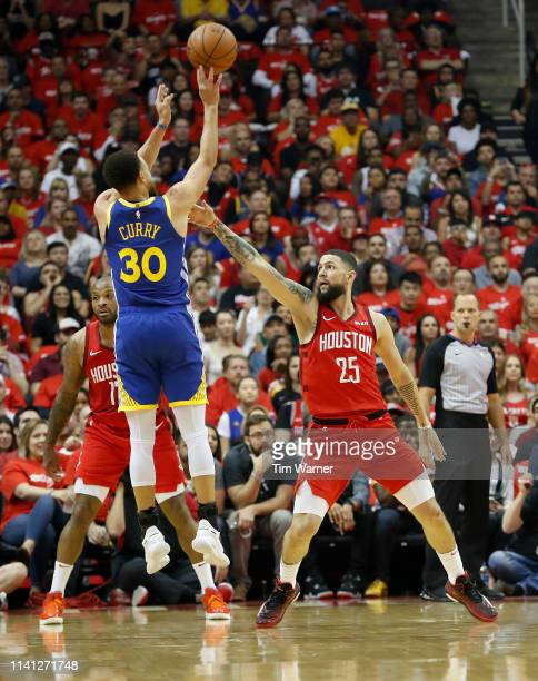 Stephen Curry of the Golden State Warriors takes a three point shot defended by Austin Rivers of the Houston Rockets in the first half during Game...