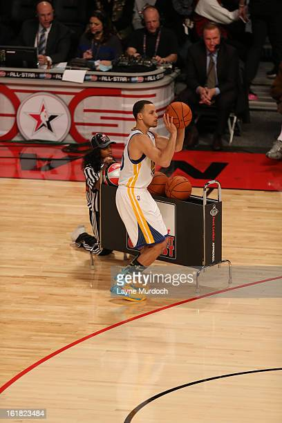 Stephen Curry of the Golden State Warriors takes a three point shot during 2013 Foot Locker ThreePoint Contest on State Farm AllStar Saturday Night...