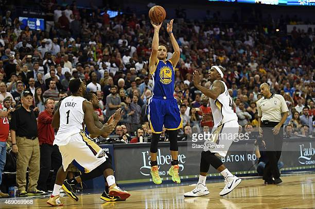 Stephen Curry of the Golden State Warriors takes a three point shot as time expires during a game against the New Orleans Pelicans at the Smoothie...