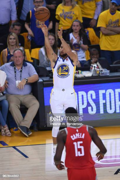 Stephen Curry of the Golden State Warriors takes a threepoint shot against the Houston Rockets during Game Six of the Western Conference Finals in...