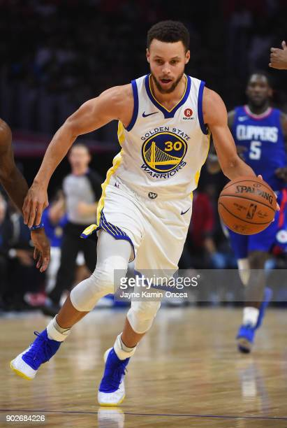 Stephen Curry of the Golden State Warriors takes the ball down court in the game against the Los Angeles Clippers on January 6 2018 in Los Angeles...