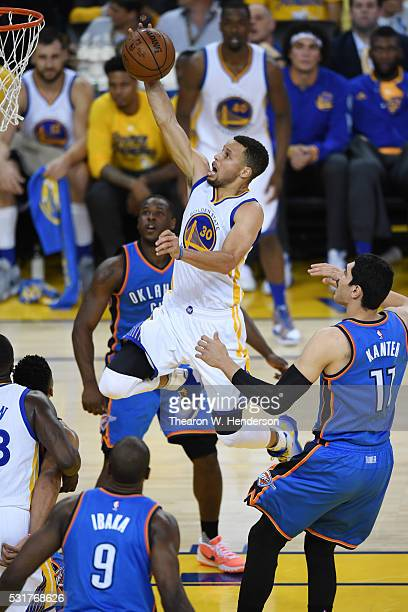 Stephen Curry of the Golden State Warriors takes the ball to the rim during game one of the NBA Western Conference Final against the Oklahoma City...