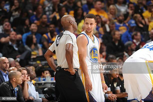 Stephen Curry of the Golden State Warriors talks to a referee during the game against the Milwaukee Bucks on December 18 2015 at Oracle Arena in...