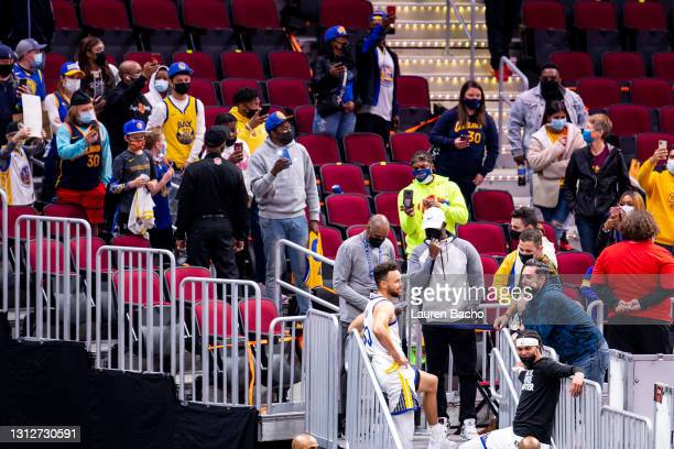 Stephen Curry of the Golden State Warriors talks to fans after the game against the Cleveland Cavaliers at Rocket Mortgage Fieldhouse on April 15,...