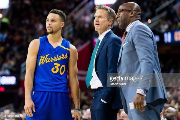 Stephen Curry of the Golden State Warriors talks to head coach Steve Kerr of the Golden State Warriors and assistant coach Mike Brown during the...