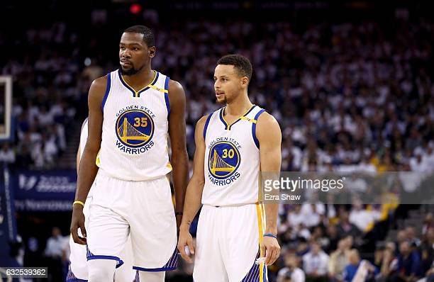 Stephen Curry of the Golden State Warriors talks to Kevin Durant during their game against the Toronto Raptors at ORACLE Arena on December 28 2016 in...