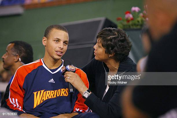 Stephen Curry of the Golden State Warriors talks with Cheryl Miller after defeating the Phoenix Suns during an NBA preseason game on October 10 2009...