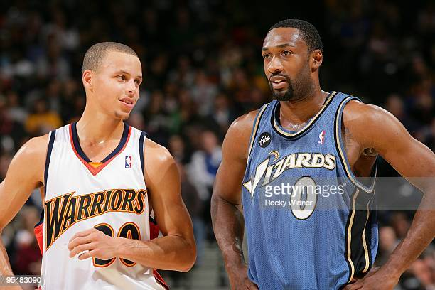 Stephen Curry of the Golden State Warriors talks with Gilbert Arenas of the Washington Wizards during the game on December 18 2009 at Oracle Arena in...