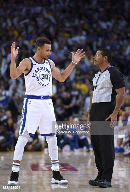 Stephen Curry of the Golden State Warriors talks with referee Bill Kennedy about a foul call made during an NBA basketball game against the...