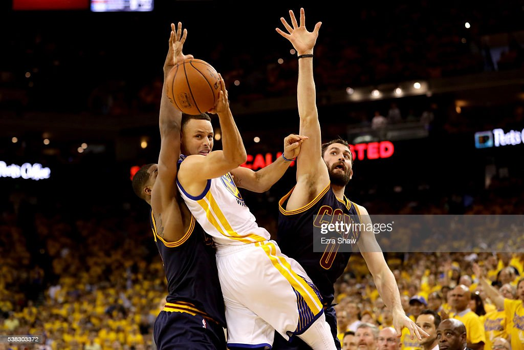 Stephen Curry #30 of the Golden State Warriors throws up a shot against Tristan Thompson #13 and Kevin Love #0 of the Cleveland Cavaliers in Game 2 of the 2016 NBA Finals at ORACLE Arena on June 5, 2016 in Oakland, California.