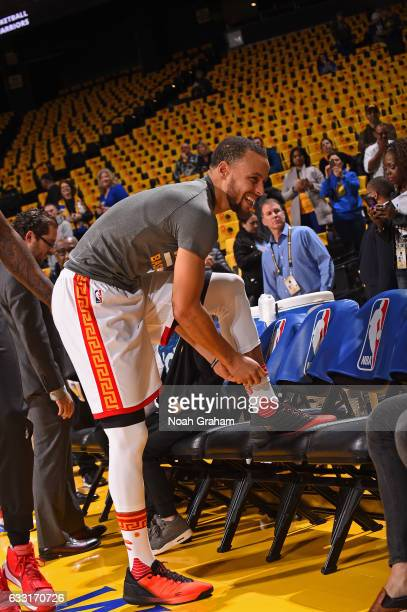 Stephen Curry of the Golden State Warriors tie his shoes before the game against the Los Angeles Clippers on January 28 2017 at ORACLE Arena in...