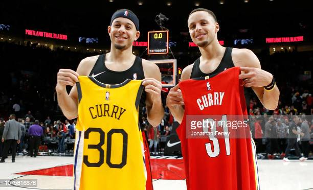 Stephen Curry of the Golden State Warriors trades jerseys after the game with his brother Seth Curry of the Portland Trail Blazers at Moda Center on...