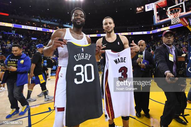 Stephen Curry of the Golden State Warriors trades jerseys with Dwyane Wade of the Miami Heat after the game on February 10 at ORACLE Arena in Oakland...