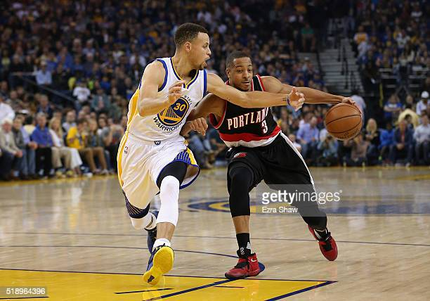 Stephen Curry of the Golden State Warriors tries to steal the ball from CJ McCollum of the Portland Trail Blazers at ORACLE Arena on April 3 2016 in...