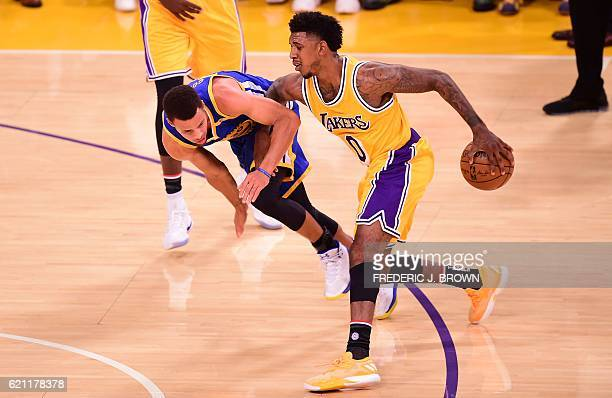 Stephen Curry of the Golden State Warriors vies for the ball with Nick Young of the Los Angeles Lakers in their NBA game in Los Angeles California on...