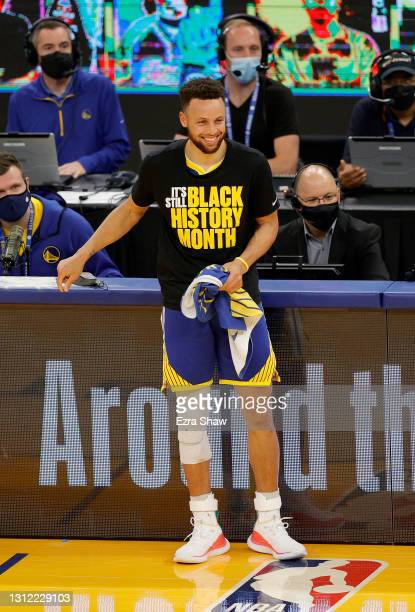 Stephen Curry of the Golden State Warriors waits to come in to their game against the Denver Nuggets at Chase Center on April 12, 2021 in San...