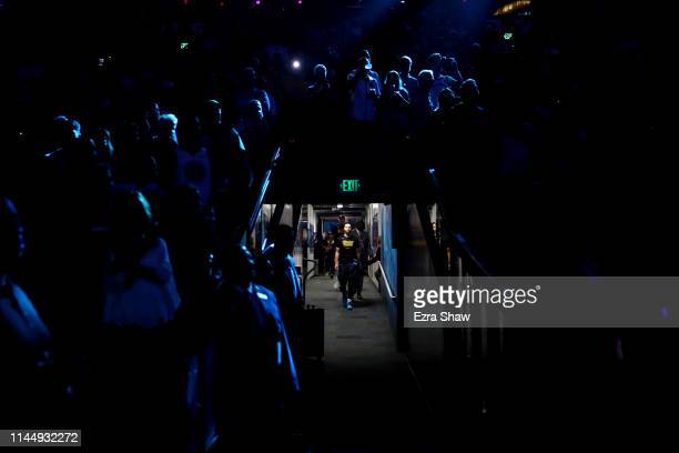 Stephen Curry of the Golden State Warriors walks down the tunnel for player introductions before their game against the LA Clippers in Game Five of...