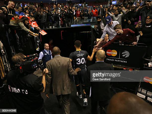 Stephen Curry of the Golden State Warriors walks off the court after the game against the Toronto Raptors on December 5 2015 at Air Canada Centre in...