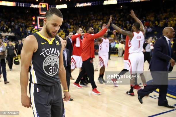 Stephen Curry of the Golden State Warriors walks off the court after losing 9592 to the Houston Rockets in Game Four of the Western Conference Finals...