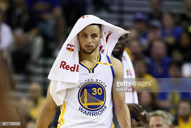 Stephen Curry of the Golden State Warriors walks to the checkin table during their game against the New Orleans Pelicans at ORACLE Arena on November...