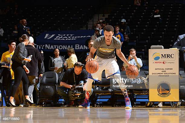 Stephen Curry of the Golden State Warriors warms up against the Los Angeles Clippers on November 4 2015 at Oracle Arena in Oakland California NOTE TO...