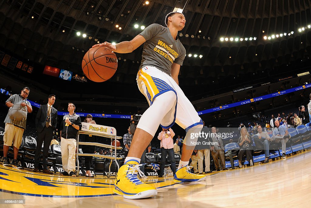 Stephen Curry #30 of the Golden State Warriors warms up before a game against the Memphis Grizzlies on April 13, 2015 at Oracle Arena in Oakland, California.