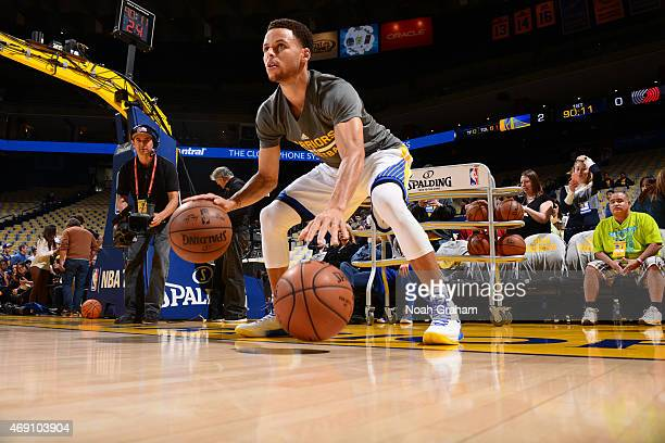 Stephen Curry of the Golden State Warriors warms up before facing the Portland Trail Blazers on April 9 2015 at Oracle Arena in Oakland California...