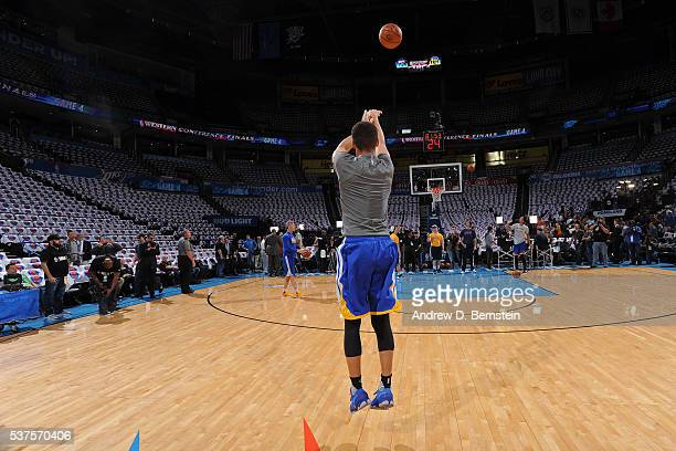 Stephen Curry of the Golden State Warriors warms up before Game Four of the Western Conference Finals against the Oklahoma City Thunder during the...