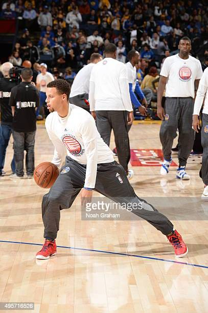 Stephen Curry of the Golden State Warriors warms up before the game against the Los Angeles Clippers on November 4 2015 at ORACLE Arena in Oakland...