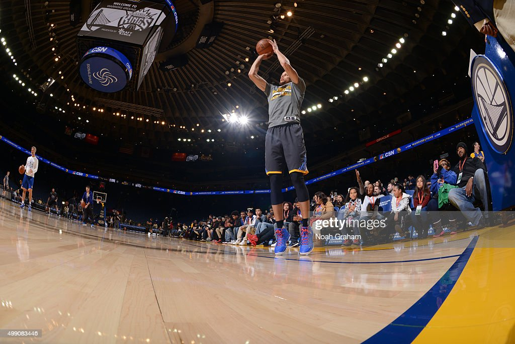 Stephen Curry #30 of the Golden State Warriors warms up before the game against the Sacramento Kings on November 28, 2015 at ORACLE Arena in Oakland, California.
