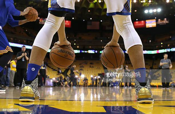 Stephen Curry of the Golden State Warriors warms up before their game against the Portland Trail Blazers in Game Five of the Western Conference...