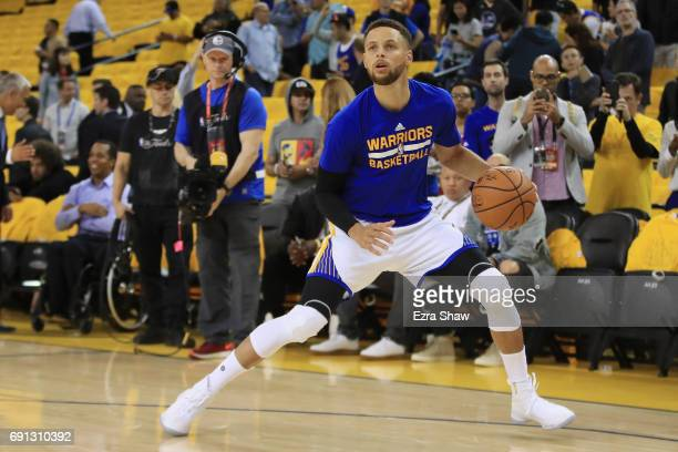 Stephen Curry of the Golden State Warriors warms up prior to Game 1 of the 2017 NBA Finals against the Cleveland Cavaliers at ORACLE Arena on June 1...