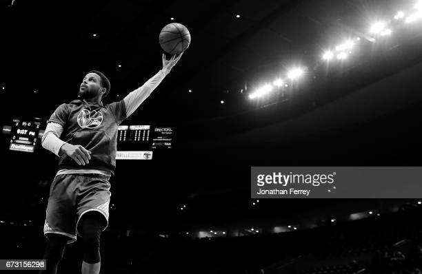 Stephen Curry of the Golden State Warriors warms up prior to the game against the Portland Trail Blazers during Game Four of the Western Conference...