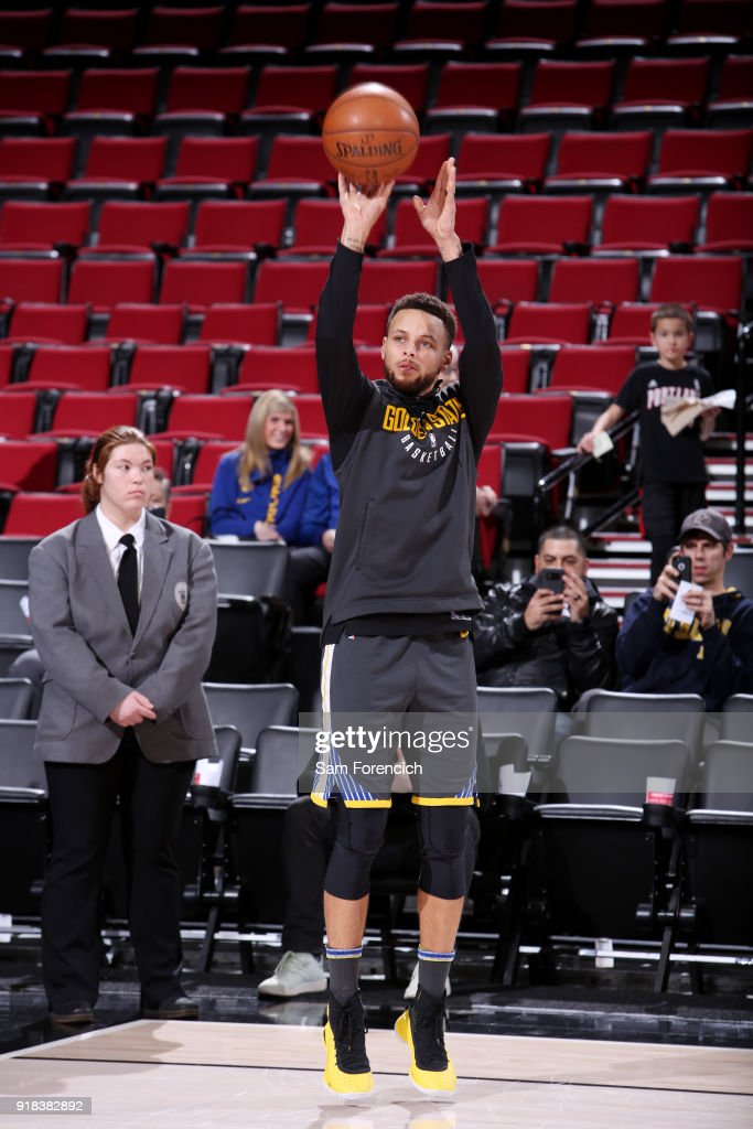 Stephen Curry #30 of the Golden State Warriors warms up prior to the game against the Portland Trail Blazers on February 14, 2018 at the Moda Center in Portland, Oregon.