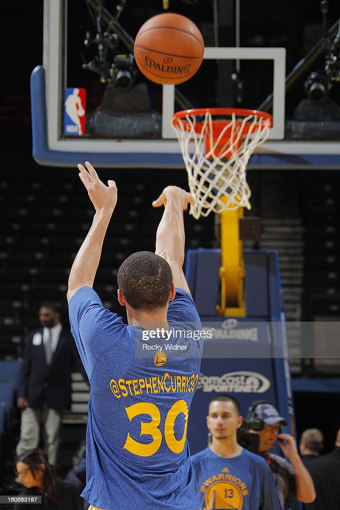 Stephen Curry #30 of the Golden State Warriors warms up wearing a shirt to promote Social Media Night before a game against the Phoenix Suns on February 2, 2013 at Oracle Arena in Oakland, California.