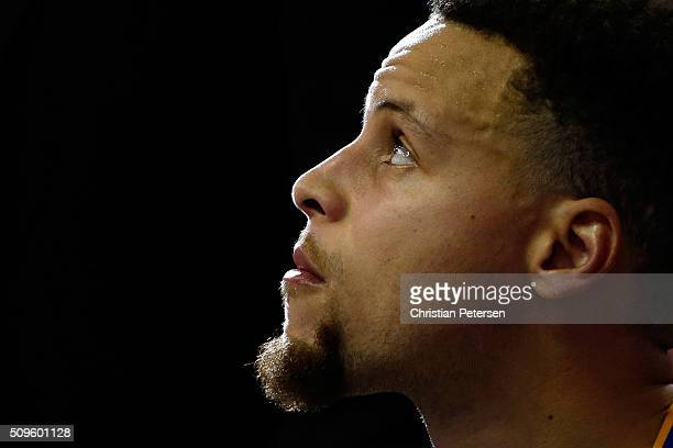 Stephen Curry of the Golden State Warriors watches from the bench during the NBA game against the Phoenix Suns at Talking Stick Resort Arena on...
