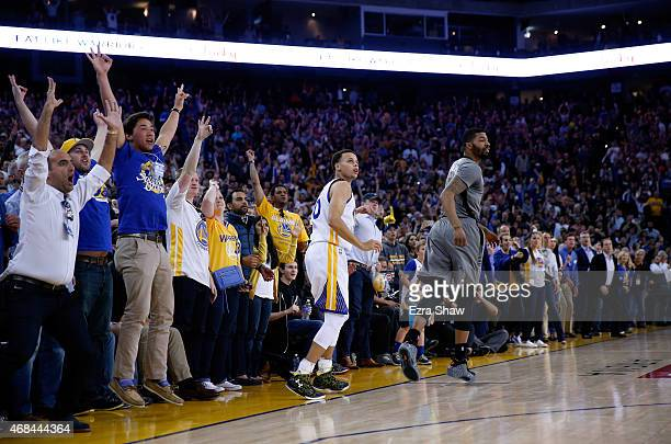Stephen Curry of the Golden State Warriors watches his threepoint basket go into the basket during the final minute of their win against the Phoenix...