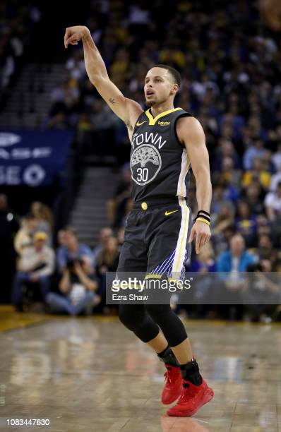 Stephen Curry of the Golden State Warriors watches one of his shots during their game against the New Orleans Pelicans at ORACLE Arena on January 16...