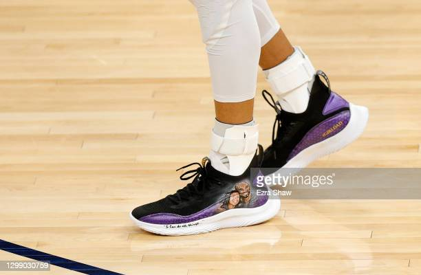 Stephen Curry of the Golden State Warriors wears custom Under Armour sneakers with a picture of Kobe Bryant and his daughter, Gianna, on them during...