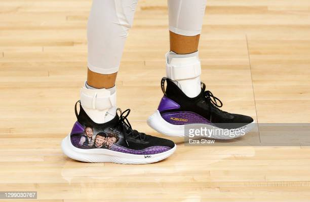 Stephen Curry of the Golden State Warriors wears custom Under Armour sneakers with a picture of himself with his two daughters, Riley and Ryan, on...