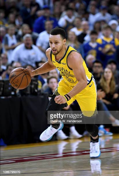 Stephen Curry of the Golden State Warriorsd dribbles the ball up court against the Los Angeles Lakers during the second half of their NBA Basketball...