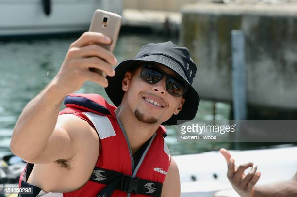 Stephen Curry of the USA Basketball Men's National Team takes a photo while on jet skis on September 7 2014 in Barcelona Spain NOTE TO USER User...