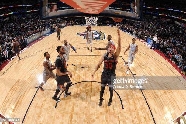 Stephen Curry of the Western Conference AllStar Team drives to the basket against the Eastern Conference AllStar Team during the NBA AllStar Game as...