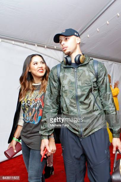 Stephen Curry of the Western Conference AllStar Team exits the arena with his wife Ayesha Curry after the NBA AllStar Game as part of the 2017 NBA...