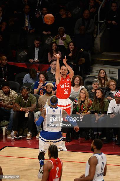 Stephen Curry of the Western Conference shoots against Carmelo Anthony of the Eastern Conference during the 2016 NBA AllStar Game on February 14 2016...