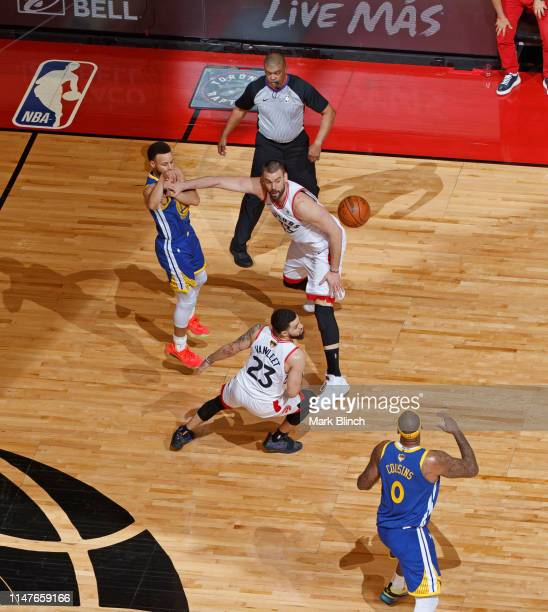 Stephen Curry passes the ball to DeMarcus Cousins of the Golden State Warriors against the Toronto Raptors during Game Two of the NBA Finals on June...