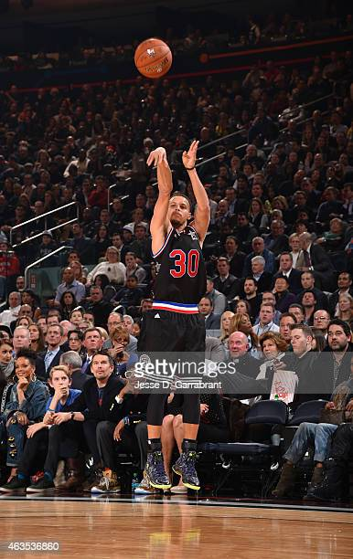 Stephen Curry playing for the West Coast allstars shoots the ball during the 2015 NBA AllStar Game at Madison Square Garden on February 15 2015 in...