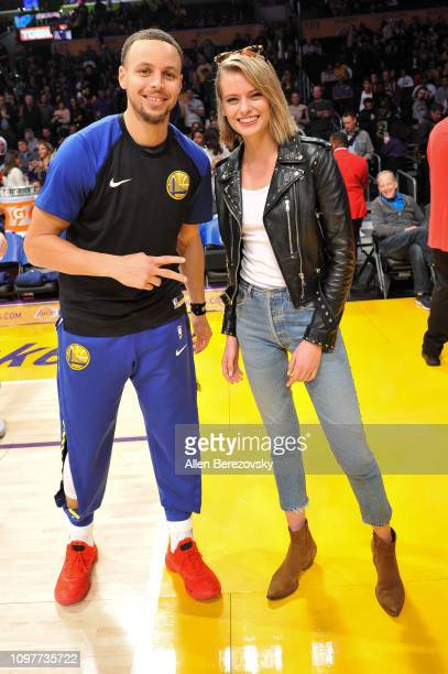 Stephen Curry poses for a picture with model Evelyn Rose before a basketball game between the Los Angeles Lakers and the Golden State Warriors at...